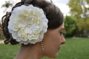 Updo Hairstyles with oversized hair flower